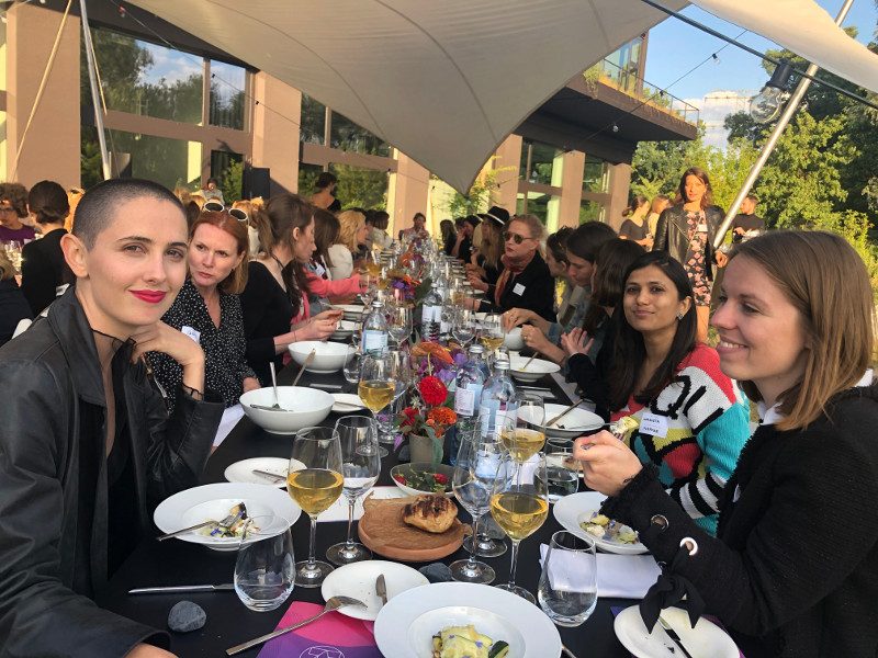 Rows of tables with fabulous women. Gorgeous evening.