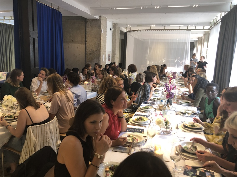 Change-Makers engaged in conversations over dinner